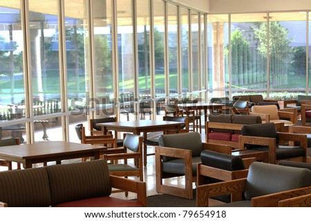Empty waiting area with large windows - stock photo