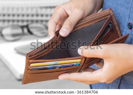 empty wallet in man hand - stock photo