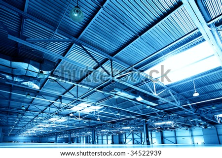 Empty warehouse toned in the blue color