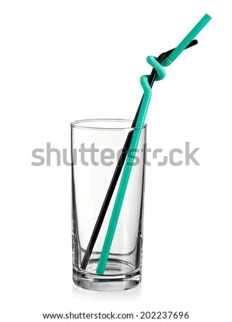Empty water glass with two straws - stock photo
