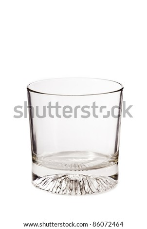 Empty whiskey glass isolated on a white background - stock photo