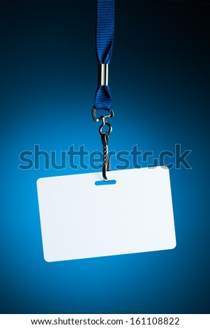 empty white badge backdrop against blue background - stock photo