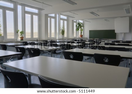 Empty white classroom from rear side view with plants. (HDR)