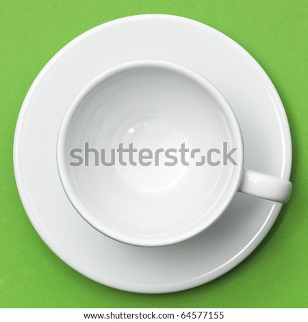Empty white cup on green placemat. Above view. Isolated on white background - stock photo
