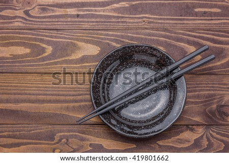 empty white dish plate on a wooden table background