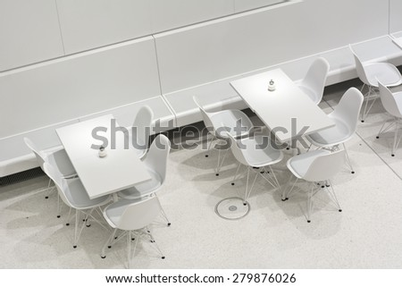 Empty White Interior Restaurant Tables in Modern European Architectural Style