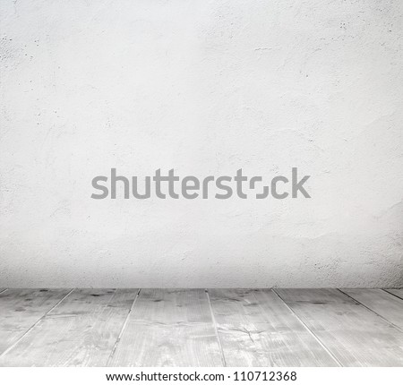 Empty white interior room with painted wall and wooden plank floor