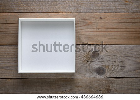 Empty white open box on wooden background