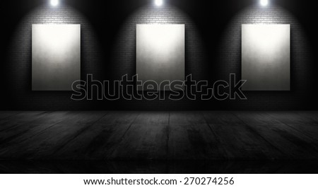 Empty white panels  in front of brick wall with spotlight - stock photo
