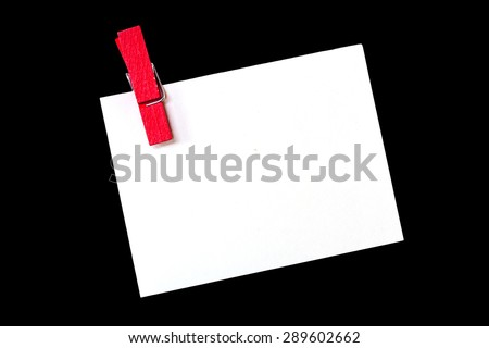 empty white paper with wood clip isolated on black  for text. - stock photo