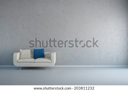 Empty white room with leather loveseat and concrete wall - stock photo