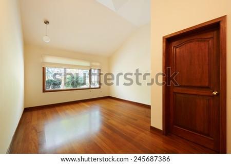 Empty white room with wooden floor - stock photo