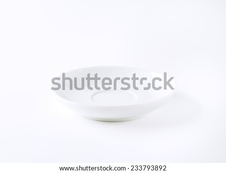 empty white saucer on white background - stock photo