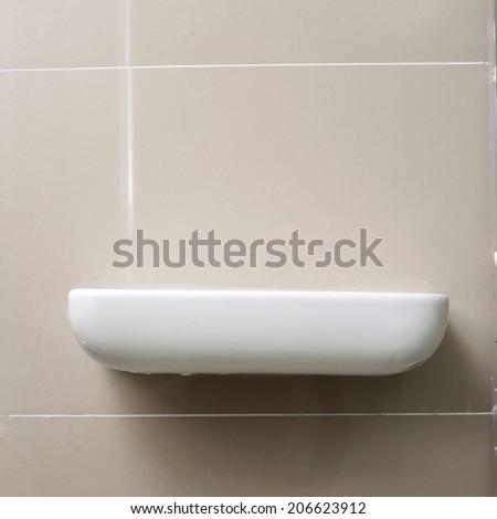 empty white shelf in bathroom - stock photo