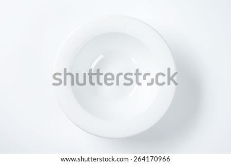 empty white soup plate on white background - stock photo