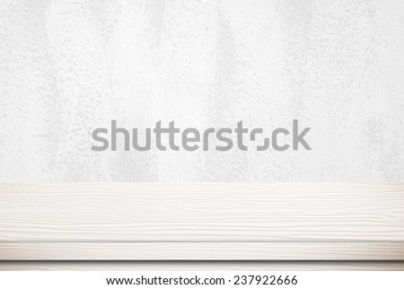 Empty white table over white cement wall, vintage, background, template, display - stock photo
