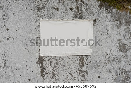 Empty white weathered advertisement glued to the grunge wall - stock photo