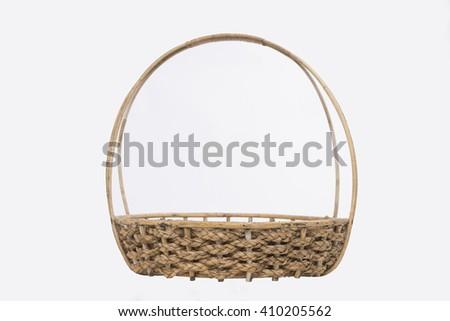 Empty wicker basket isolated on white background - stock photo