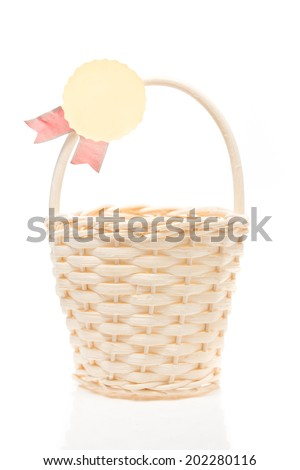 empty wicker basket with empty badges isolate on white background.