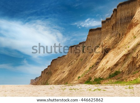 Empty wild Black Sea beach under the coast precipice in Odessa region, Ukraine