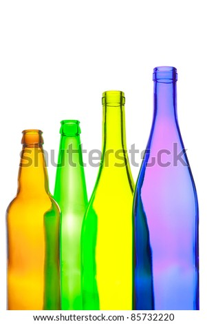 Empty wine and beer bottles on white background - stock photo