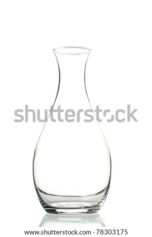 empty wine decanter on white background. vertical composition
