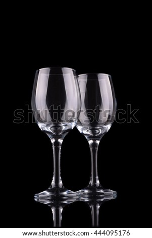 Empty wine glass isolated on black
