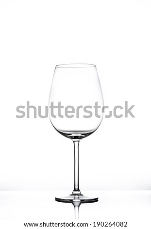 Empty wine glass isolated on white seamless background - stock photo