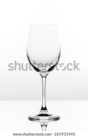 Empty wine glass on a white background - stock photo