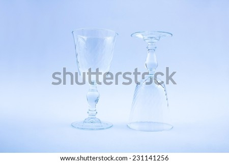 Empty wine glass on blue filter background