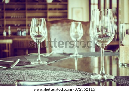 Empty wine glass on dining table in restaurant -  Vintage Filter and Selective focus point