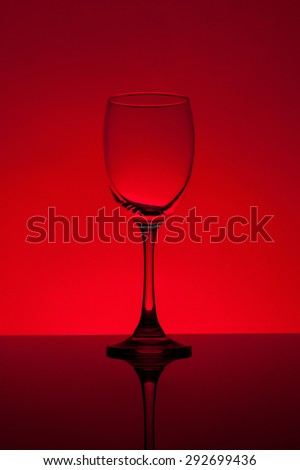 empty wine glass on red background