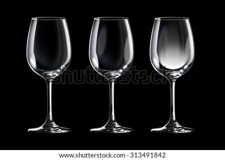 Empty wine glass set isolated on black background - stock photo