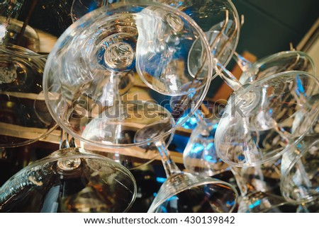 empty wine glasses, abstract art. Image is vintage effect and some noise added. low key photo - stock photo