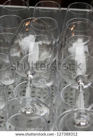 Empty wine glasses at flea market in Paris. - stock photo