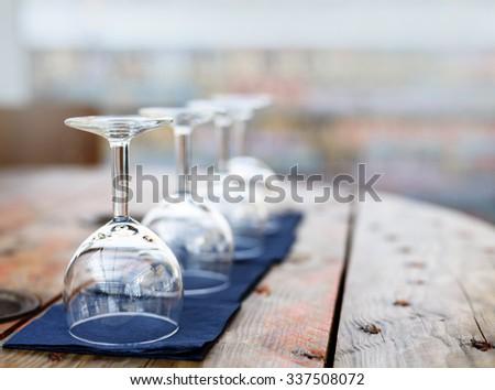 Empty wine glasses in restaurant. - stock photo