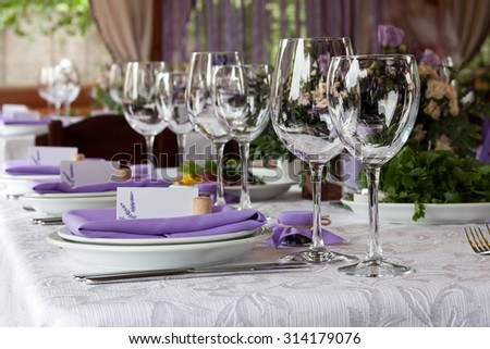 Empty wine glasses set in restaurant - stock photo