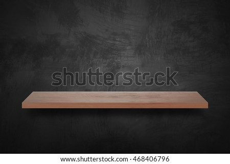 Empty wood bar with grunge black wall background