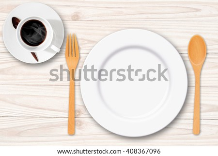 Empty wood plate with spoon fork and coffee cup on white table - stock photo