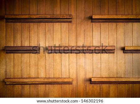 Empty wood shelf on wood decorative wall - stock photo