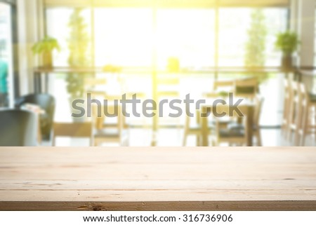 Empty wood table and blurred cafe light background. product display template. Business presentation - stock photo