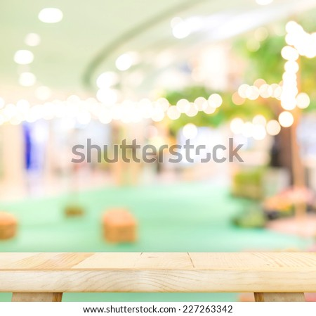 Empty wood table and blurred Festival area in shopping mall background. product display template.Business presentation - stock photo