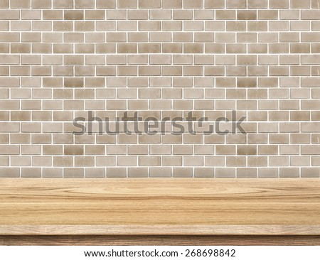 Empty wood table and red brick wall in background. product display template - stock photo