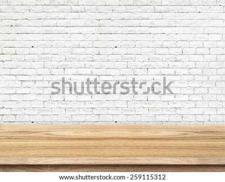 Empty wood table and white brick wall in background. product display template - stock photo