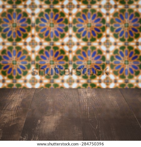 Empty wood table top and blur vintage ceramic tile pattern wall in background, Mock up template for display of your product. - stock photo