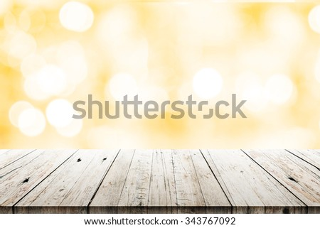 Empty wood table top on blurred christmas background. can montage or display your products - stock photo
