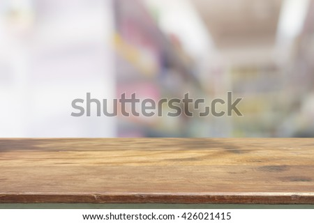 Empty Wood Table Top Ready For Your Product Display Montage. With Book Shelf  In Library