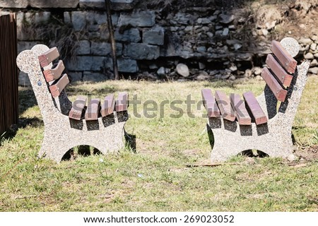 Empty wooden bench in the public park. - stock photo