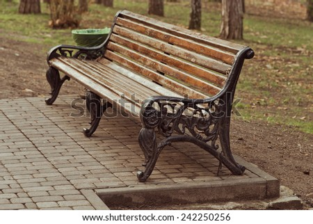 Empty wooden benches in the park - stock photo