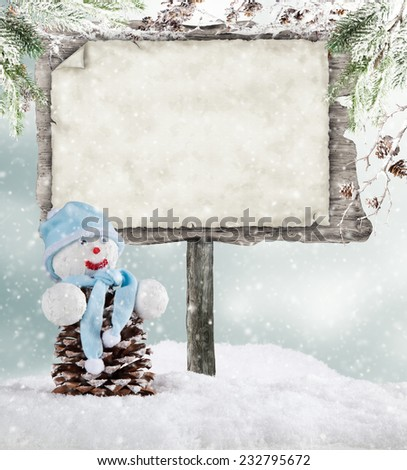 Empty wooden board with copyspace for text. Christmas concept with snowman - stock photo